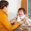 Stock Photo: Daughter caring for sick mother has cold