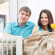 Stock Photo: Couple near oil heater