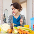 Beautiful woman cooking vegetarian lunch — Stock Photo
