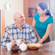 Happy mature couple having breakfast — Stock Photo