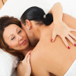 Adult couple having sex on white sheet — Stock Photo