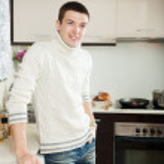 Portrait of man at kitchen interior — Stock Photo