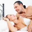 Stock Photo: Loving middle-aged couple awaking together