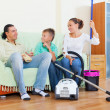 Stock Photo: Tired family after cleaning