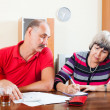Mature couple calculating family budget — Stock Photo