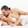 Stock Photo: Middle-aged couple awaking in bed