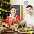 Happy family celebrating Christmas over celebratory table — Stock Photo
