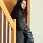 Woman in coat opening door — Stock Photo #40794813
