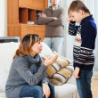 Mother and father scolding son at living room — Stock Photo #40795119