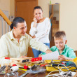 Family doing something with instruments — Stock Photo #40795163