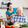 Joyful mature couple cooking food — Stock Photo