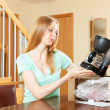 Beautiful young blond with new coffee machine at home — Stock Photo #40795339