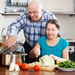 Mature couple cooking together — Stock Photo #40795345