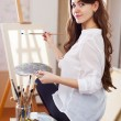 Artist with oil colors and brushes — Stock Photo