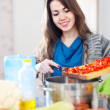 Stock Photo: Housewife cooking veggie lunch