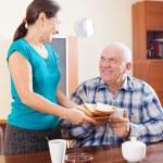 Happy mature couple having breakfast — Stock Photo