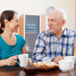 Smiling mature couple having tea — Stock Photo