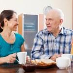 Smiling mature couple having tea — Stock Photo