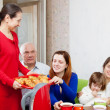 Family communicate over tewith cakes — Stock Photo #40795705