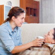Stock Photo: Daughter caring for sick mature mother