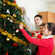 Parents and child preparing for Christmas — Stock Photo #40795921