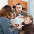 Stock Photo: Couple giving cough syrup to unwell boy