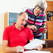Senior family with financial documents — Stock Photo