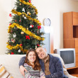 Couple near a Christmas tree — Stock Photo