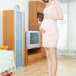 Pregnant woman standing on bathroom scales — Stock Photo