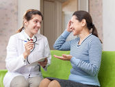 Friendly doctor asked happy female patient feels — Stock Photo