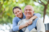 Senior couple in park — Stock Photo