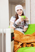 Girl relaxing with cup of tea in winter — Stock Photo