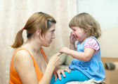 Woman berates crying baby — Stock Photo