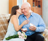 Mature man presenting woman jewel — Stock Photo