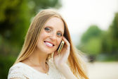 Woman calling by mobile with copyspace — Stock Photo