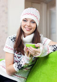 Girl warms with cup of tea — Stock Photo