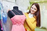 Girl chooses evening gown — Stock fotografie