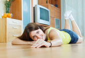 Happy beautiful woman on parquet floor — Stock fotografie