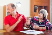Couple having quarrel over documents — Stock Photo