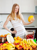 Long-haired woman with melon — Stock Photo