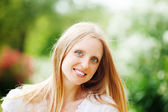 Smiling beautiful blonde middle-aged woman — Stock Photo