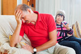 Sad mature man listening to angry wife — Stock Photo