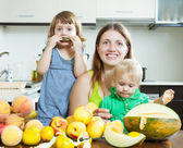 Happy family together with melon — Stock Photo