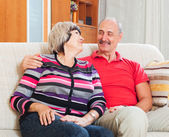 Smiling mature man with wife in home — Stock Photo