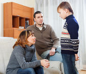 Mother and father scolding son — Stock Photo