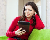 Woman using tablet computer or electronic book — Stock Photo