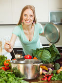 Girl cooking with vegetables in domestic kitchen — Stock Photo