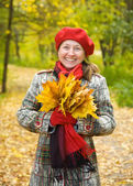 Laughing mature woman in autumn — Stock Photo