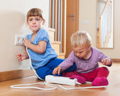 Children playing with electrical extension and outlet — ストック写真