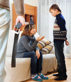 Mother and father with belt scolding teenager son — Stock Photo